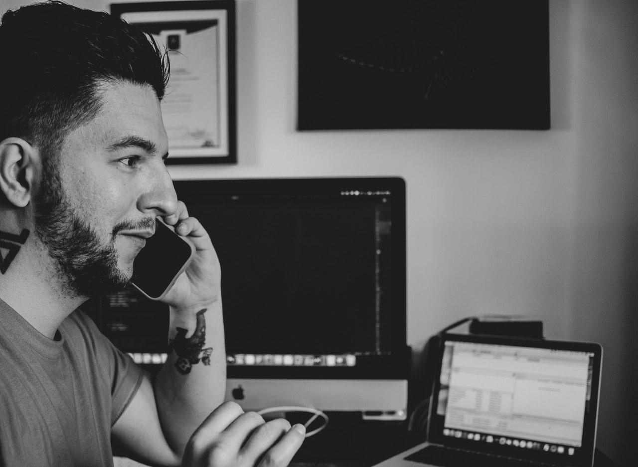 galicki-digital-about-talking-through-phone-black-white